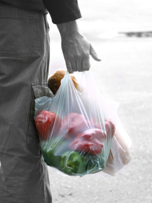 Plastic Shopping Bag filled with Peppers